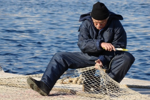 Mend Net Croatian Fisherman